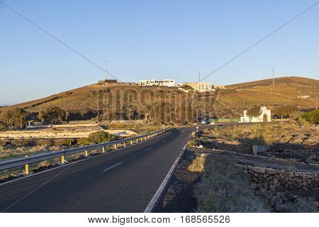 Road In Hilly Area With Farm Houses In Lanzarote