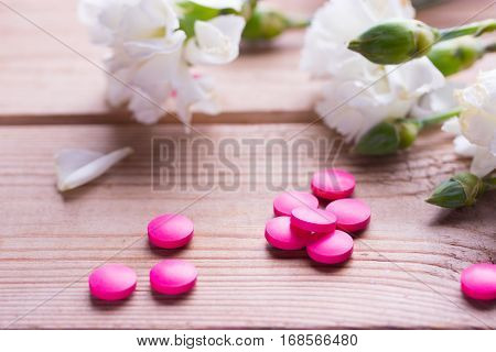 Birth control pink pills and white flower