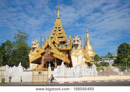 YANGON, MYANMAR - DECEMBER 17 2016: The entrance to the Shwedagon pagoda on a sunny day