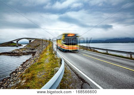 Public bus traveling on the road in Norway. Public bus in motion blur. Atlantic Ocean Road or the Atlantic Road (Atlanterhavsveien) been awarded the title as