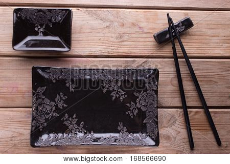 Black Painted Chopsticks And Empty Square Plate