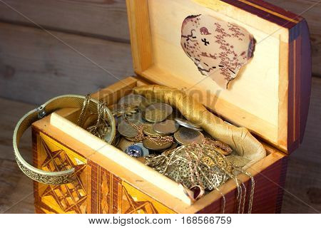 Treasure chest old coins and treasure map
