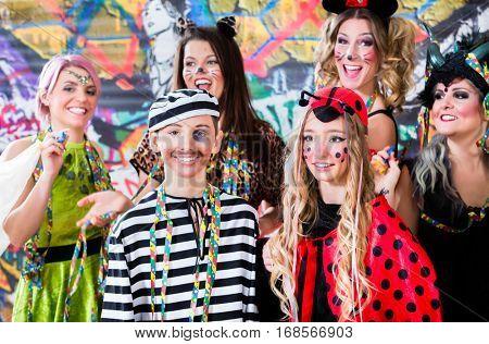 Young women celebrating German fasching Carnival at Rose Monday parade