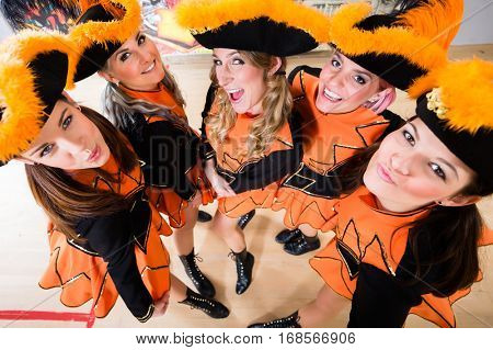 Costumed girls with tricorns from carnival club during Carnival