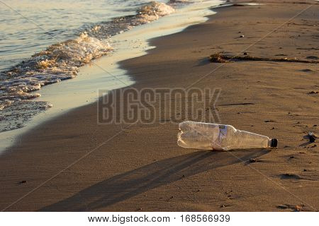 Plastic bottle on the beach. ecology concept