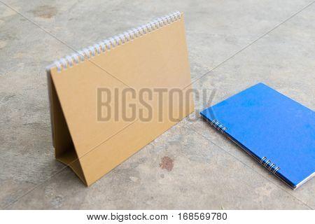 Blank paper desk spiral calendar brown and blue spiral calendar