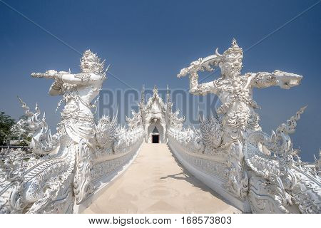 Beautiful ornate white temple located in Chiang Rai northern Thailand. Ð¡ontemporary unconventional Buddhist temple on april 27 2016