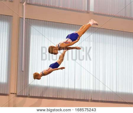 Orenburg, Russia December 4, 2016: The Boys Compete In Synchronous Jumping On A Trampoline