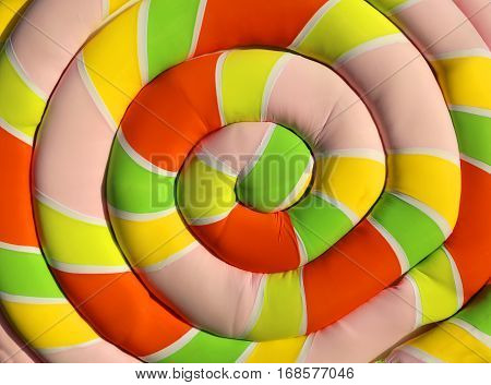 big soft pillow shaped like a giant marshmallow with a spiral colorful