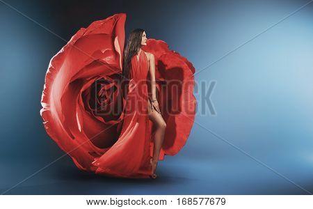 Beautiful brunette wearing rose dress