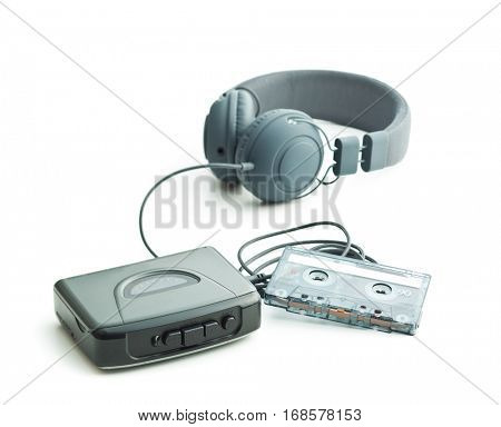 The vintage audio player and headphones isolated on white background.