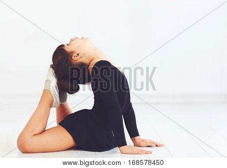 Cute Girl Making Basket Stretch On Dance Class In Ballroom School