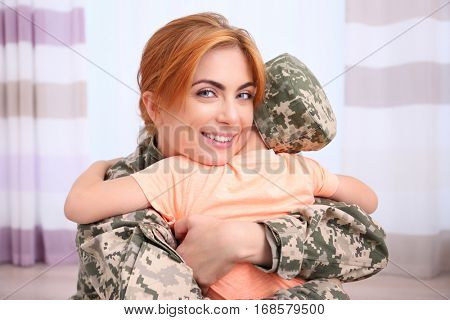 Mother soldier and little kid in the room
