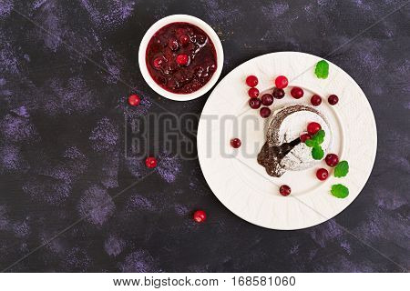 Chocolate Fondant With Cranberry Sauce. Top View.
