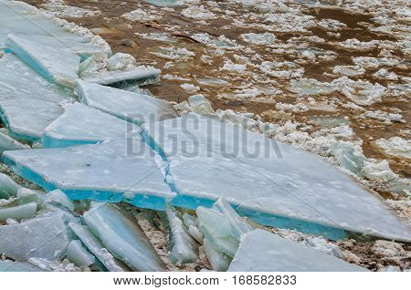 Ice floes in the river bank during an ice drift.