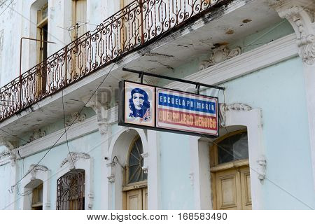 Cienfuegos Cuba - 18 january 2016: A billboard of a school with an image of Che Guevara in the city of Cienfuegos in central Cuba