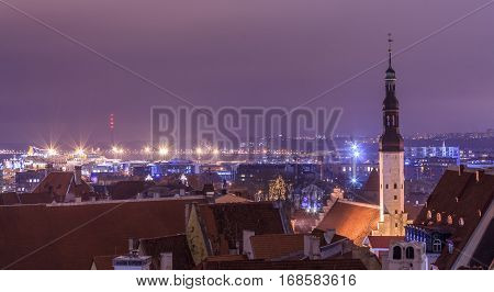 Historical Centre of Tallinn, behind the modern capital, Estonia. Night church, skyscrappers, sea port, landscape, Dark evening panoramic view