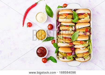 Mini Hamburgers With Chicken Burger, Cheese And A Vegetables. Flat Lay. Top View.
