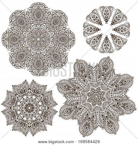 Set of four abstract vector round lace design mandalas, decorative elements. Mehndi style, traditional oriental ornament. Illustration for print, tattoo