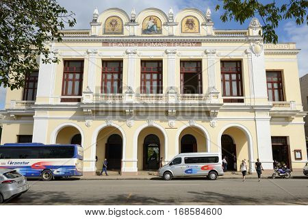 Cienfuegos Cuba - 18 january 2016: People walking and taking pictures in front of Theater Tomas Terry building. The old town is a UNESCO World Heritage Site.