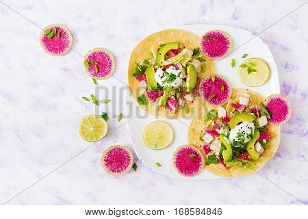 Healthy Mexican Corn Tacos With Boiled Chicken Breast, Avocado And Watermelon Radish And Yogurt Dres