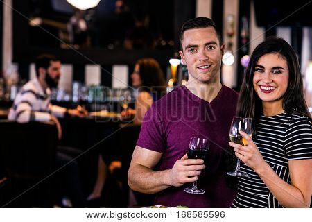 Portrait of couple having a glass of wine in a bar