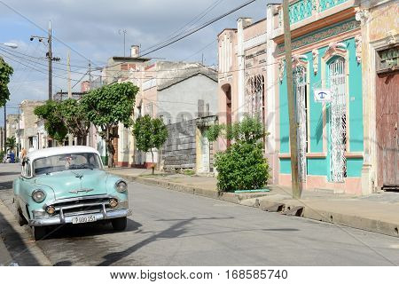 Cienfuegos Cuba - 18 january 2016: People walking in front of colonial architecture at the old town of Cienfuegos Cuba