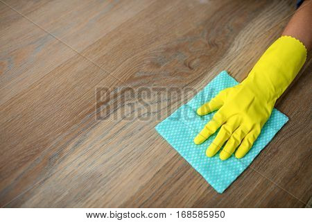 Woman cleaning up the table in the kitchen