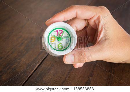 Mini white clock in hand stock photo