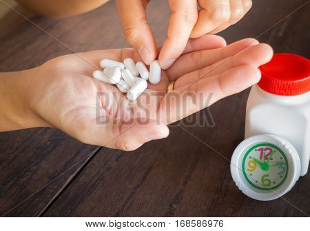 White pills medicine headache on hand stock photo