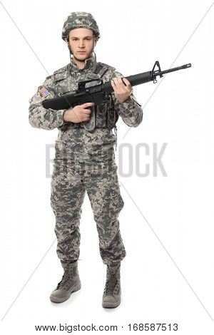 Soldier with assault riffle on white background