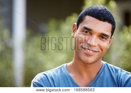 Portrait of smiling young African American man, close up