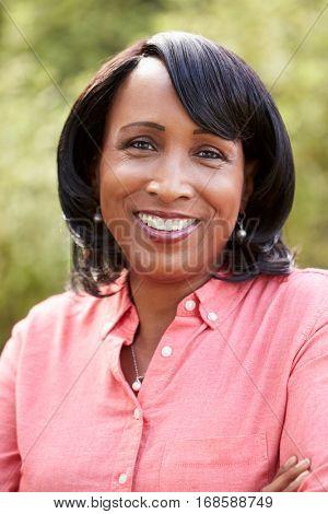 Portrait of smiling senior African American woman, vertical