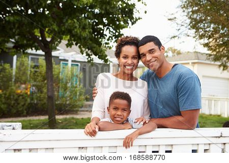 Young African American family outside their new house