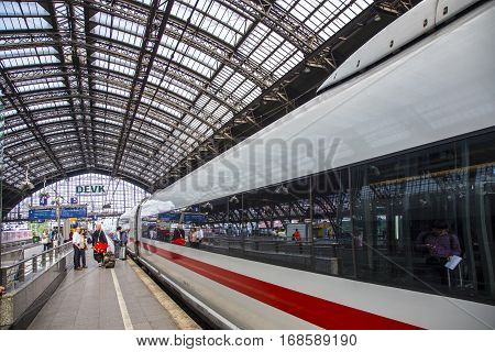 COLOGNE GERMANY - SEP 7 2014: people hurry to the intercity train in Cologne Germany. An average about 280000 travellers use this Station from 1857 daily.