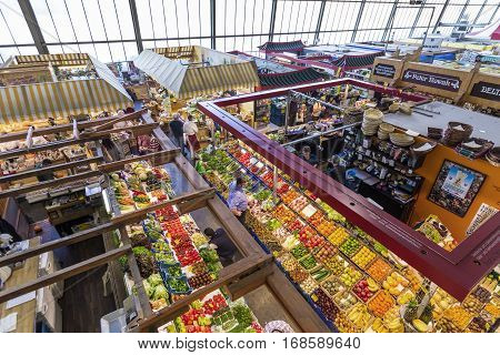 People Enjoy Shopping In The Kleinmarkthalle In Frankfurt, Germany