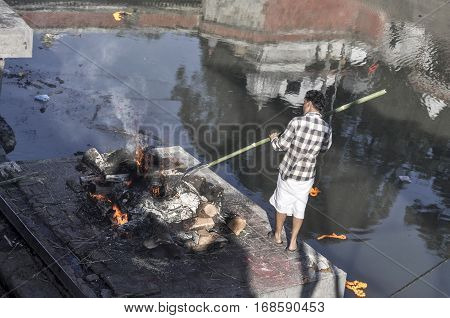 Hindu Cremation Rituals At The Banks Of Bagmati River At Pashupatinath Temple
