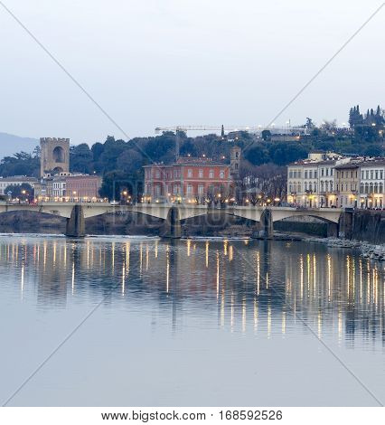 Florence Italy sunset view from Ponte Vecchio on the river Arno and Ponte Santa Trinita a Renaissance bridge the oldest elliptic arch bridge in Europe