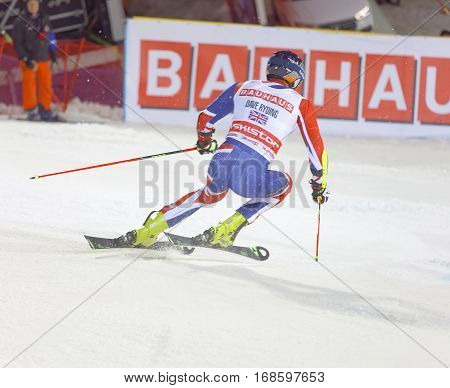 STOCKHOLM SWEDEN - JAN 31 2017: Rear view of Dave Ryding (GBR) downhill skiing in the parallel slalom alpine event Audi FIS Ski World Cup. January 31 2017 Stockholm Sweden