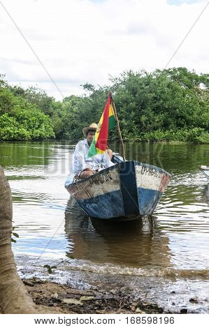 Madidi river - MAY 5: Instant of a boat with people sailing in the river on May 5 2015 in Beni Region Bolivia. The rivers are the main roads in the Amazon jungle.
