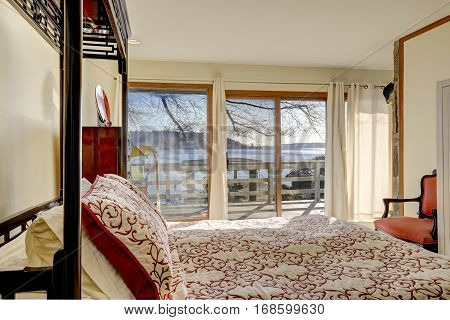 Sun Filled Bedroom Boasts King Size Canopy Bed