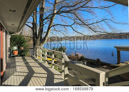 Large Spacious Deck Of Grey Waterfront Home