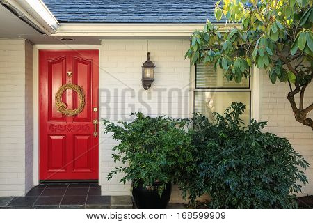 White Brick Front Porch With Red Door
