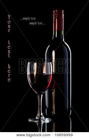 Glass of wine and bottle of wine on white