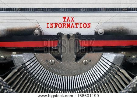 TAX INFORMATION Typed Words On a Vintage Typewriter Conceptual
