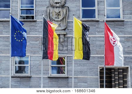 Flags of the European Union, Germany and g.Halle opposite the Town Halle, g.Halle, Germany, 06/27/2016
