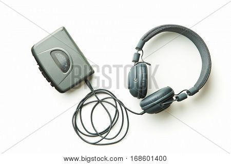 Vintage audio player and headphones isolated on white background.