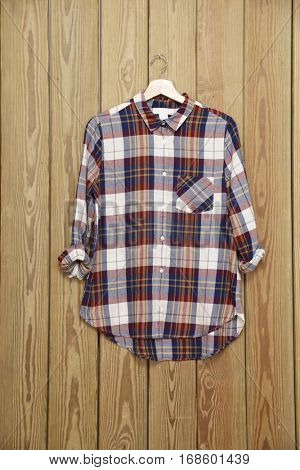 cotton shirts sleeved plaid -wooden background