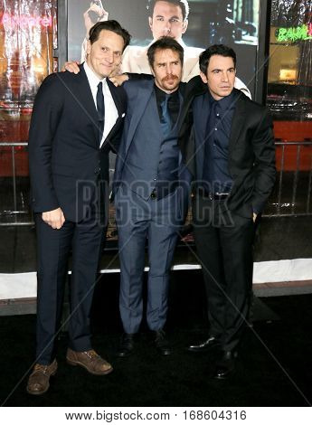 Matt Ross, Sam Rockwell and Chris Messina at the Los Angeles premiere of 'Live By Night' held at the TCL Chinese Theatre in Hollywood, USA on January 9, 2017.