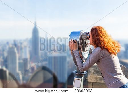 Woman looking in observation binoculars.